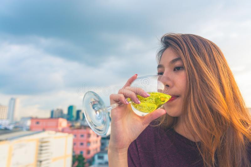 Woman in Purple Top Drinking on Clear Wine Glass royalty free stock image