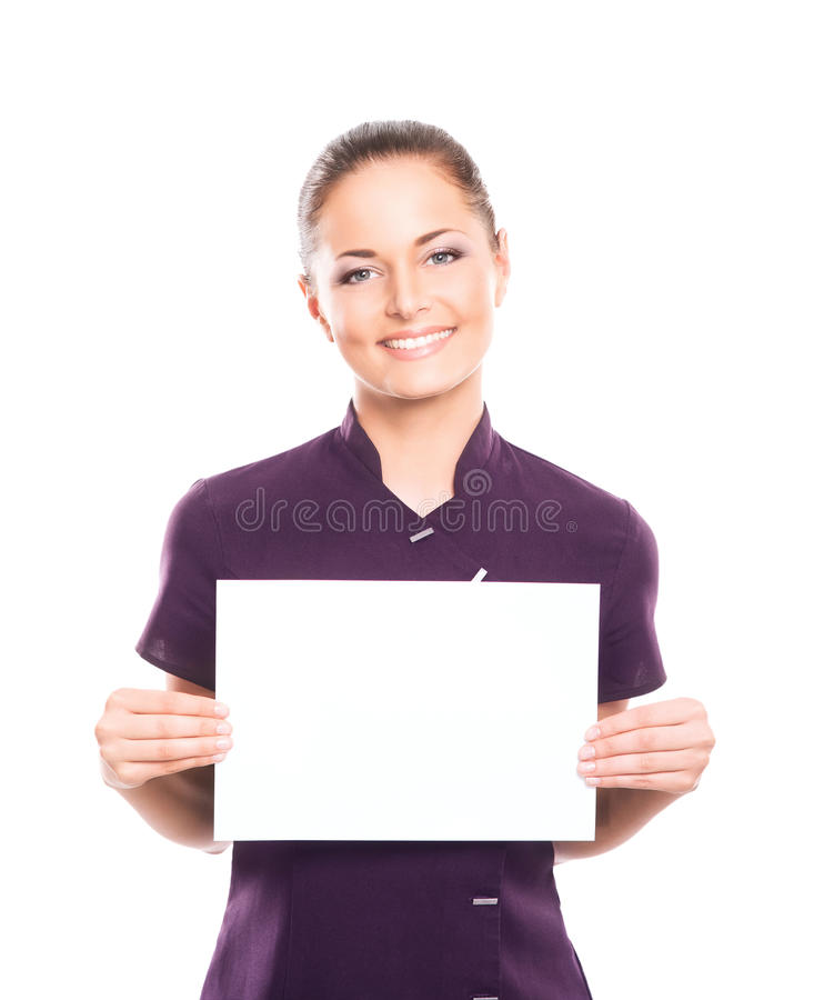 A woman in a purple uniform holding a paper. Young, happy and attractive girl in a uniform isolated on white (massage worker or sushi waiter robe royalty free stock images