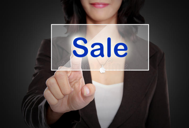Woman push to Sale button on virtual screen. Portrait of Business woman push to Sale button on virtual screen stock photo