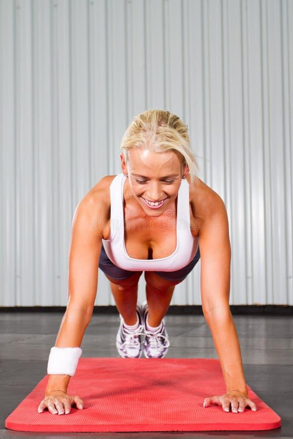 Woman push ups stock image