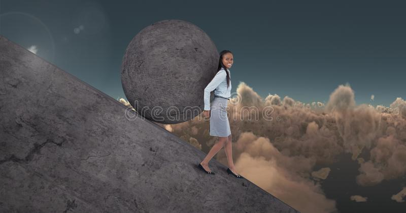 Woman pushing rolling round rock stock photos