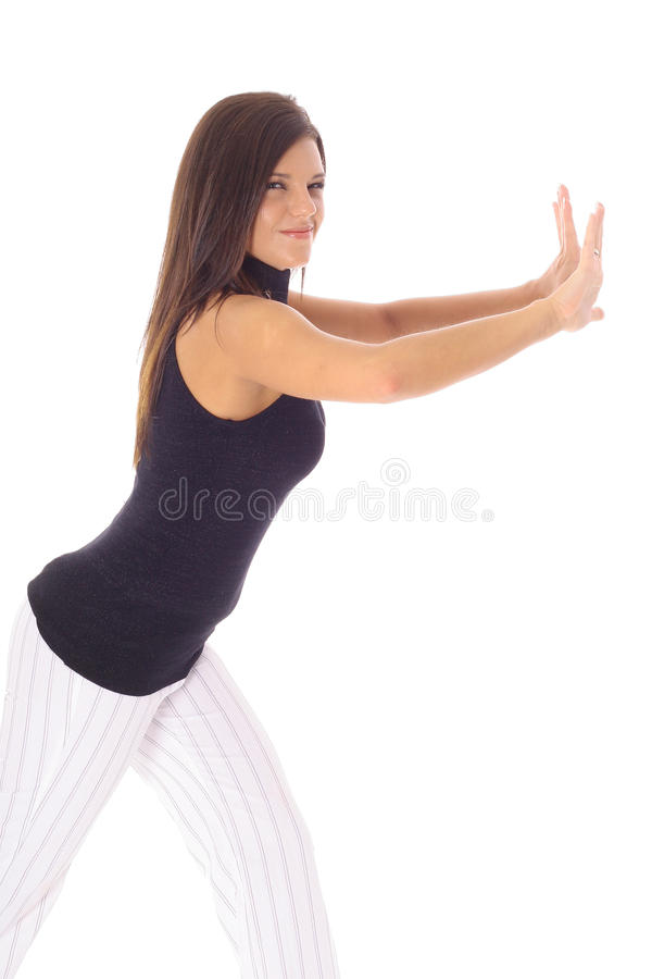 Woman pushing your object. Shot of a woman pushing your object stock photos