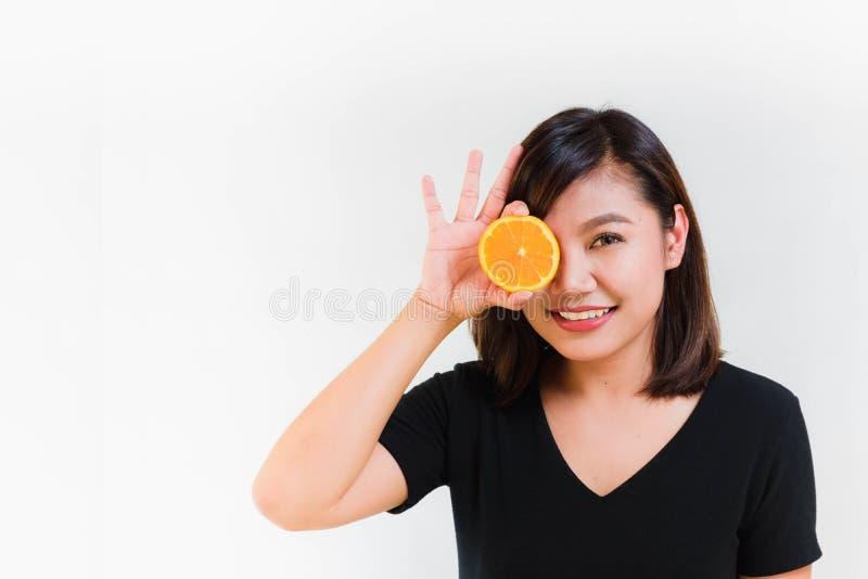 Woman Put Orange on Her Eye royalty free stock photo