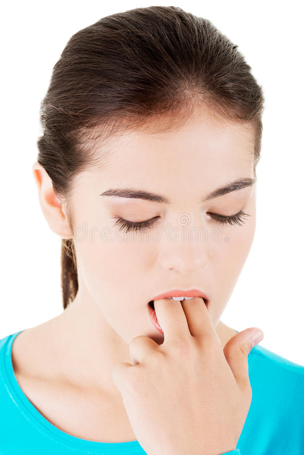 Woman putting her finger in her mouth to provoke vomiting. Isolated on white background stock photography