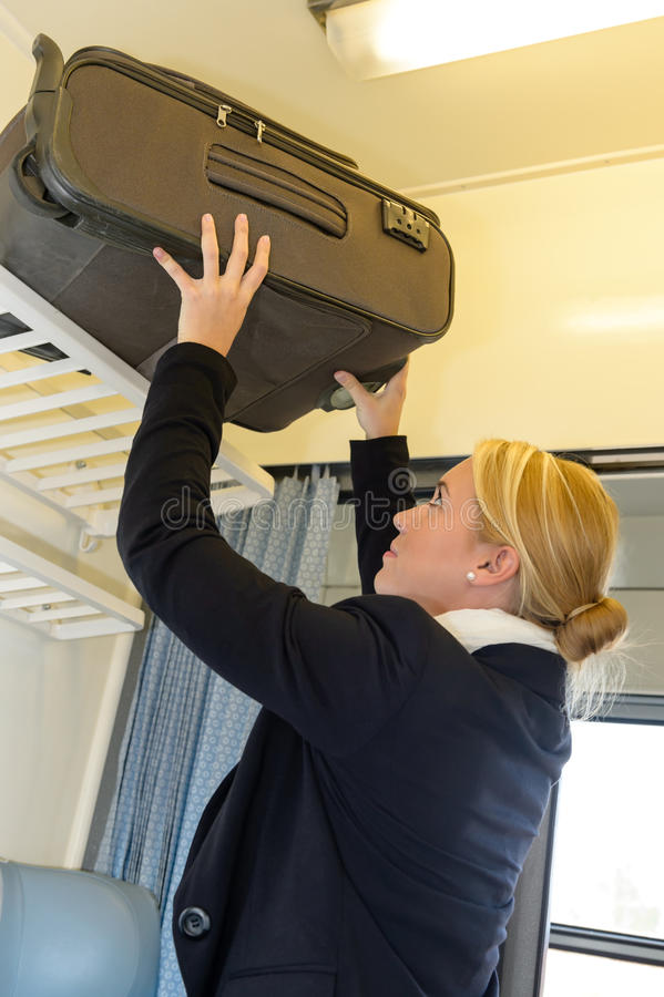 Download Woman Putting Her Luggage On Train Grid Royalty Free Stock Photo - Image: 28147095
