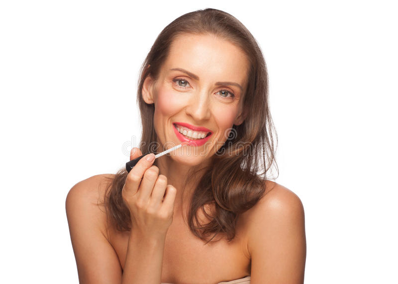 Download Woman putting on lip gloss stock photo. Image of closeup - 26704800