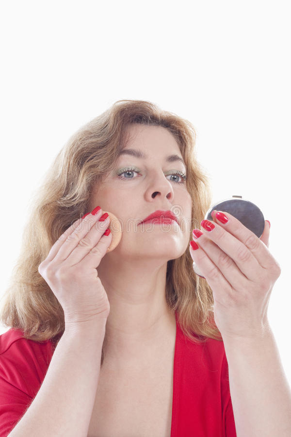 Woman Putting On Makeup Stock Photo