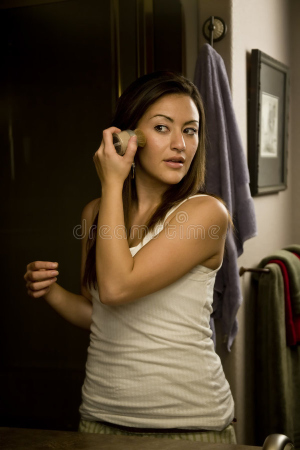 Download Woman Putting On Makeup Royalty Free Stock Images - Image: 7637539