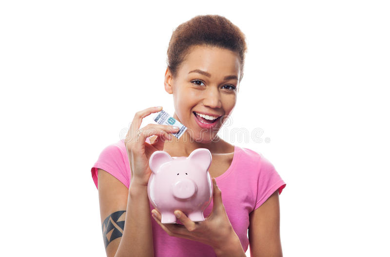 Download Woman Putting Money In Piggy Bank Stock Image - Image: 38692317