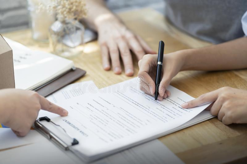 Woman putting signature on document loan contract, real estate purchase, hands of woman sale represent point document to sign, royalty free stock photography