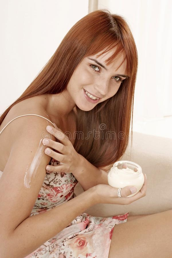 Woman putting some cream royalty free stock images