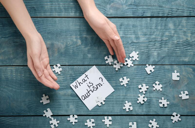 Woman, puzzle pieces and sticky note with phrase stock images