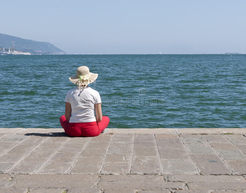 Woman On Quayside In Summer Sunshine Stock Photo
