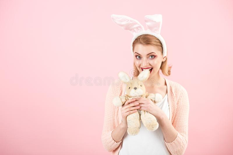 Woman in rabbit bunny ears. Egg hunt. Easter eggs as traditional food. Spring holiday. Girl with hare toy. happy woman. In bunny ears with toy. Happy easter royalty free stock image