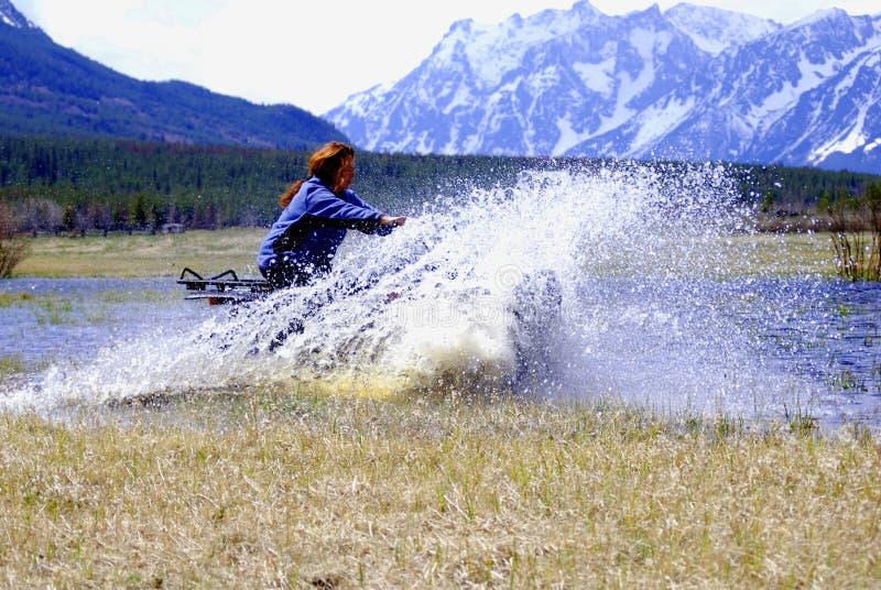 woman racing ATV stock image