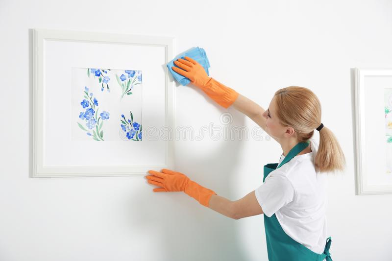 Woman with rag cleaning. Home stock photos
