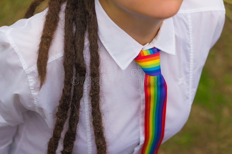 Woman with a rainbow tie stock photo