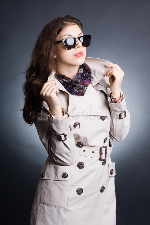 Download Woman In The Raincoat And Sunglasses Royalty Free Stock Photos - Image: 21136058
