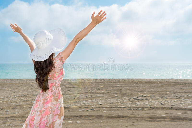 Woman raise her arms and open hands showing royalty free stock photo