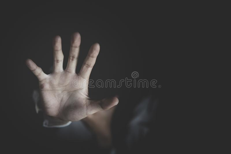 Woman raised her hand for dissuade, The concept of stopping violence against women andand human trafficking, Stop sexual stock photography