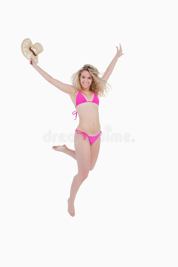 Woman Raising Her Arms While Flicking Her Leg Back Stock Photos