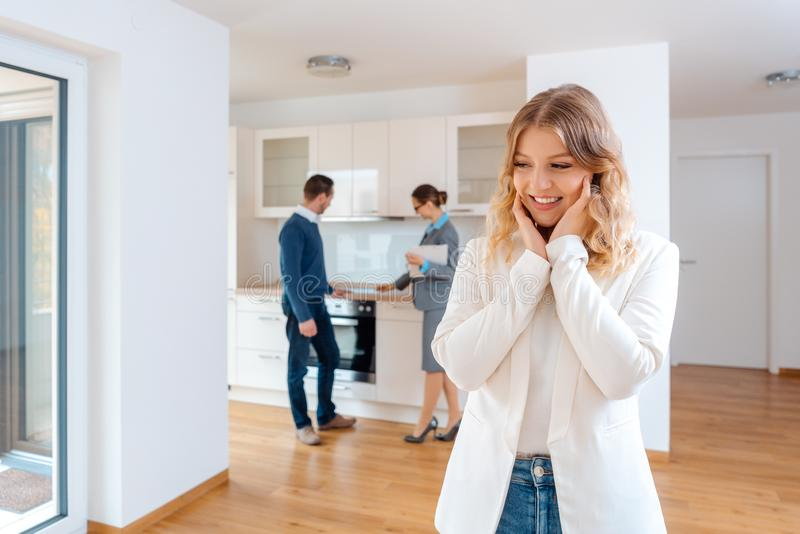 Woman raving about the apartment she and her man are going to rent. Woman raving about the apartment she and her men are going to rent or purchase royalty free stock image