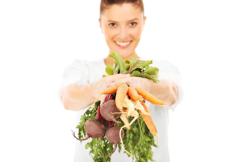 Woman with raw vegetables royalty free stock photography