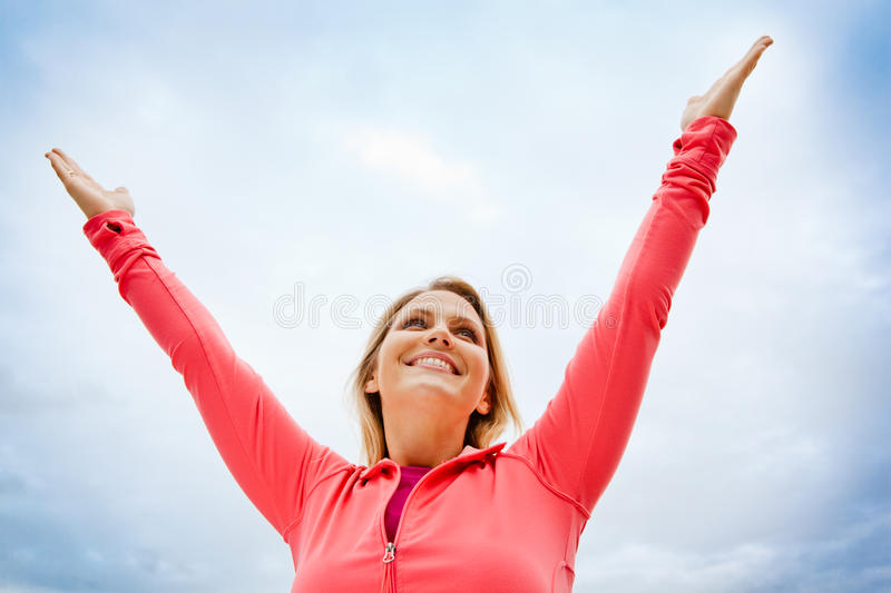 Woman reaching for the sky royalty free stock photos