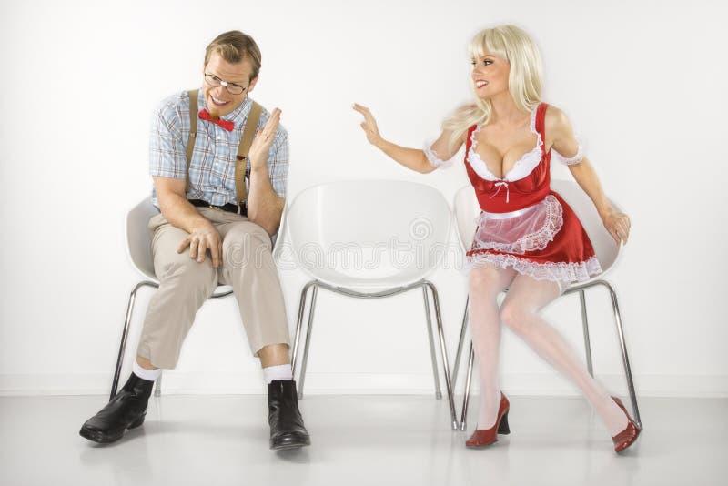 Woman reaching to male nerd. royalty free stock photo