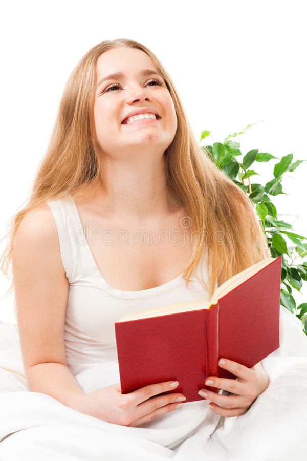 Woman Read Book Sitting In Bed Royalty Free Stock Photography