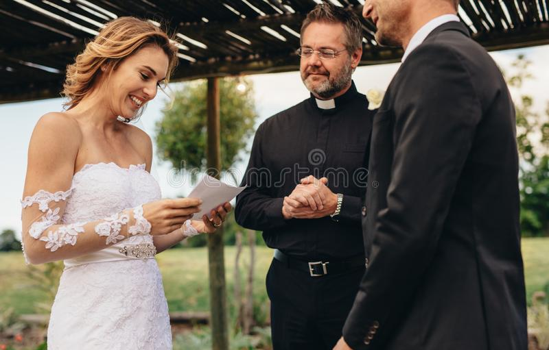 Woman read wedding vows for her husband royalty free stock photo