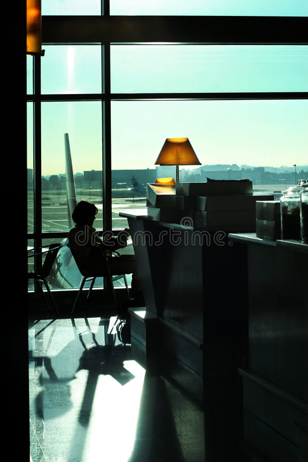 Woman reading at the airport royalty free stock photos