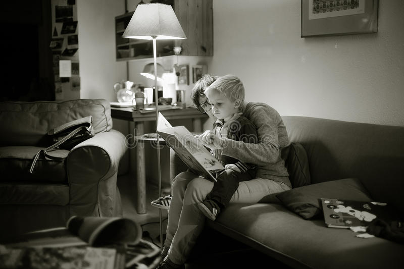Woman reading with baby