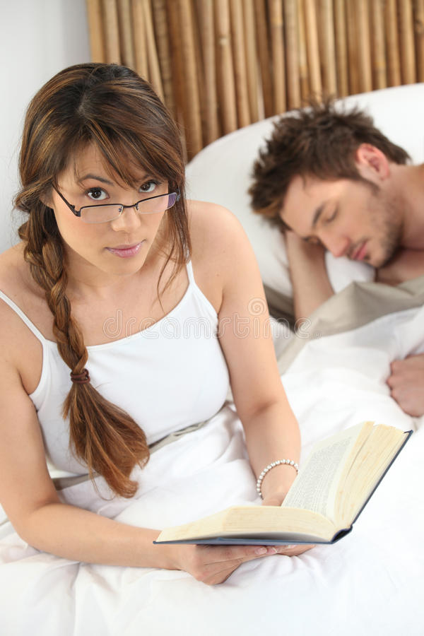 Download Woman reading in bed stock image. Image of modern, reading - 25436305