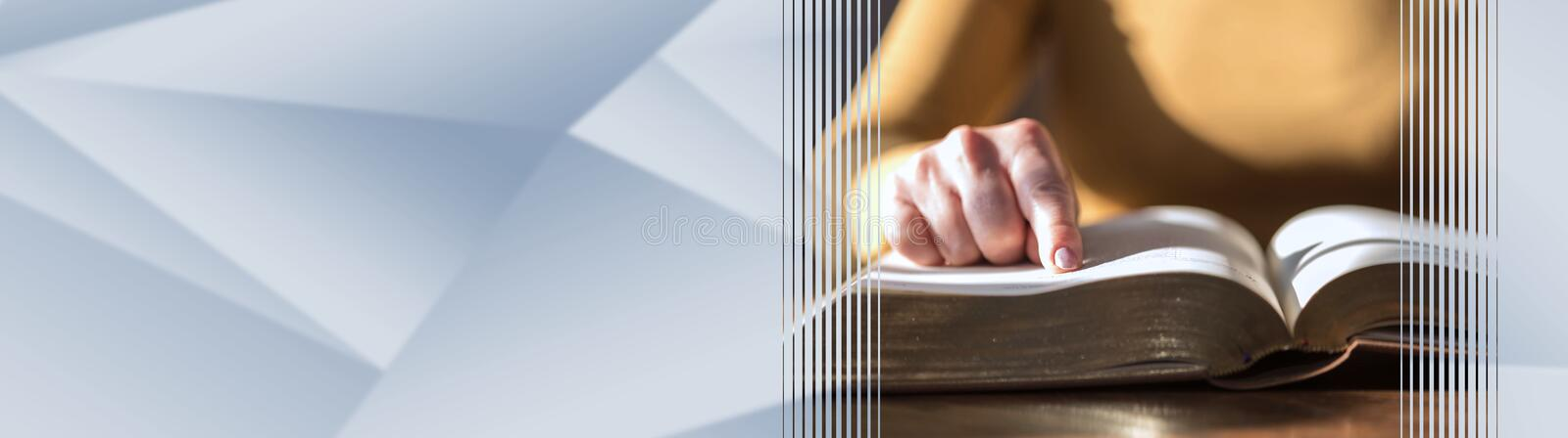 Woman reading the bible, hard light. panoramic banner royalty free stock photo