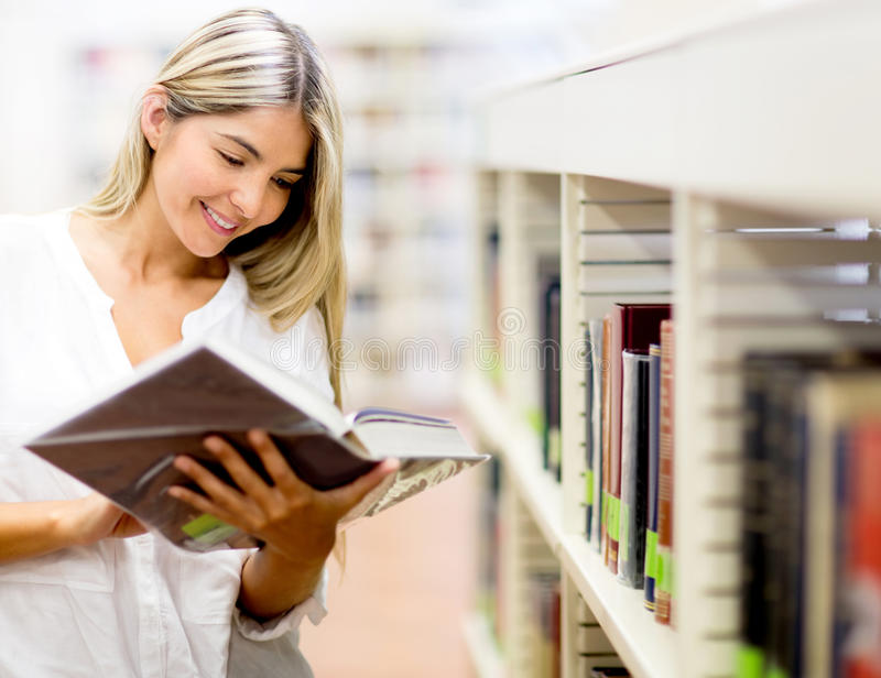 Download Woman reading a book stock image. Image of content, person - 25449447