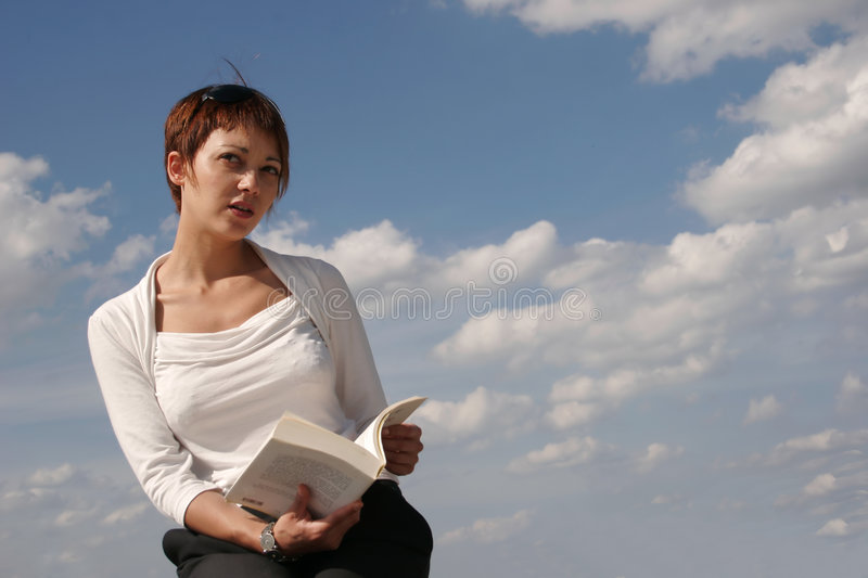 Woman reading a book royalty free stock image
