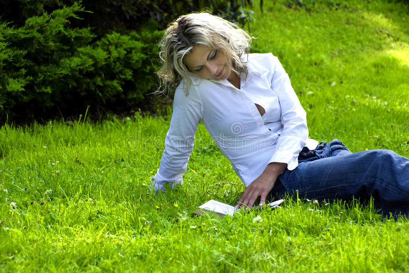Download Woman reading book stock photo. Image of blonde, person - 9486998