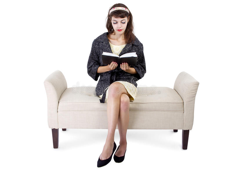 Woman Reading a Book on a Chaise Lounge royalty free stock photos