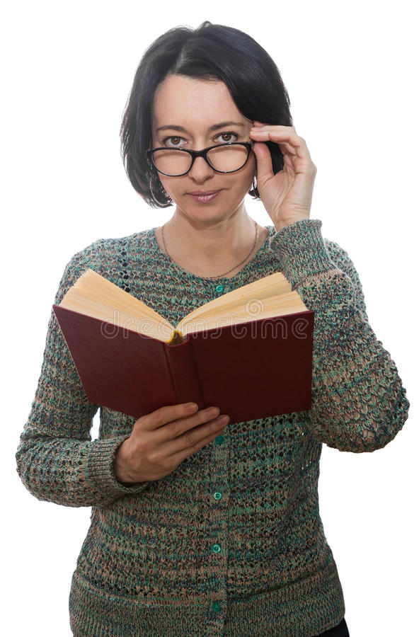 Woman reading a book. Woman forty years old, with glasses reading a book royalty free stock images