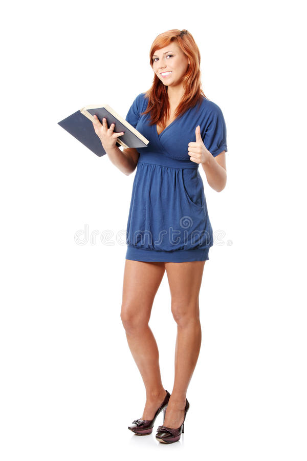 Woman reading book and gesturing OK. Young student woman reading book and gesturing OK, isolated on white background royalty free stock image