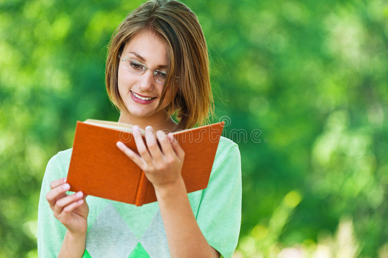 Woman reading book with glasses
