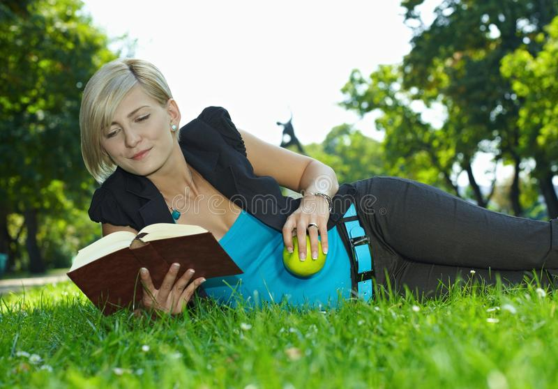 Woman Reading Book Outdoor Royalty Free Stock Photos