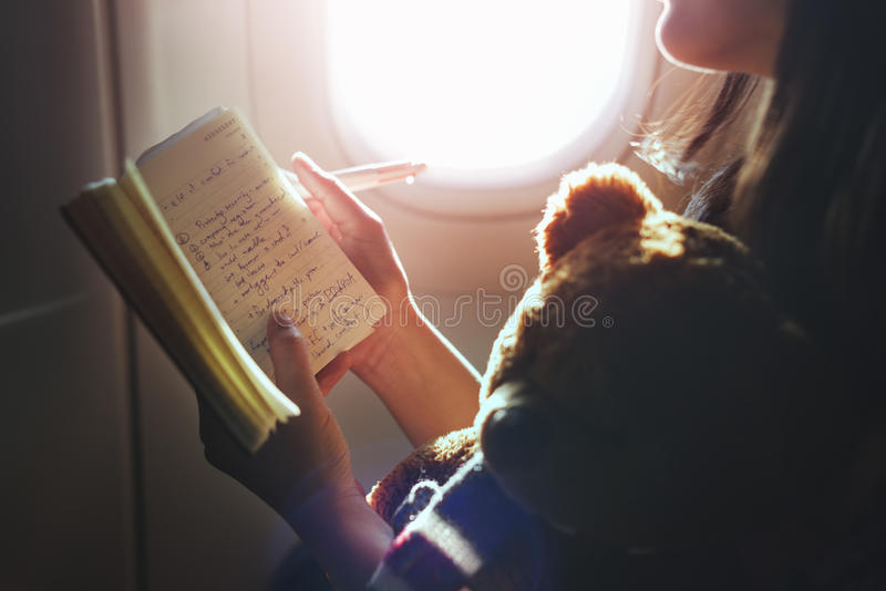 Woman Reading Book Plane Flying Concept stock images