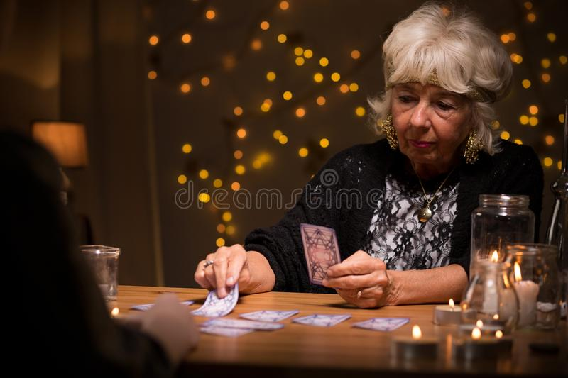Woman reading cards royalty free stock photos