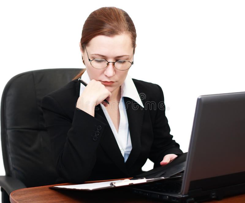 A woman reading documents stock images