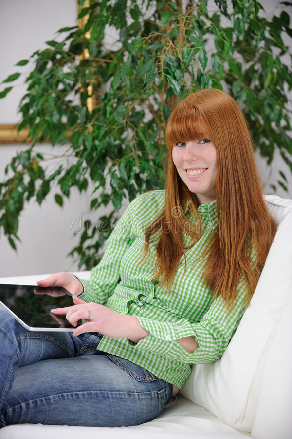 Woman Reading An Ebook On Her Digital Tablet Stock Photography