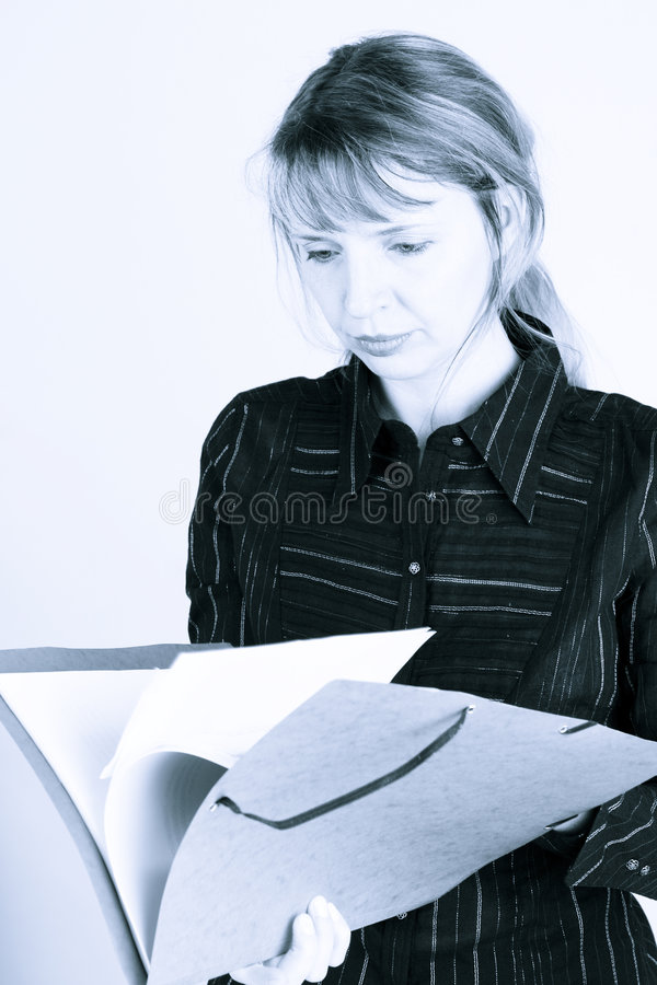Download A Woman Reading Through A Folder (2) Stock Photo - Image: 2677426
