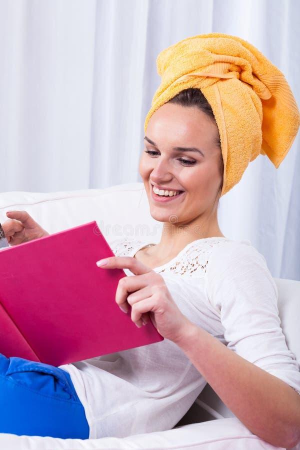Woman reading funny book stock photos