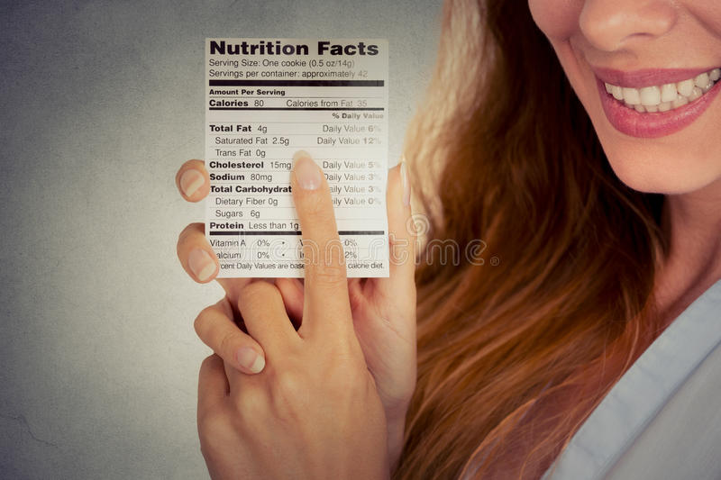 Woman reading healthy food nutrition facts stock photo